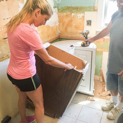 DIY Kitchen Renovation Series {ripping out the old cabinets}