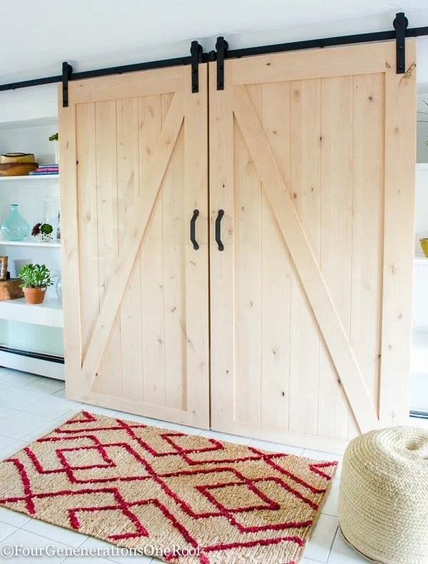 DIY sliding barn doors by Masonite. Easy to install kit which includes all rolling door hardware.