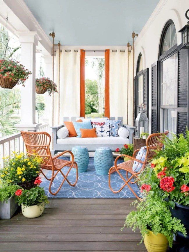 front porch ideas / Front Porch Swing and Drapes Conversation Area via HGTV