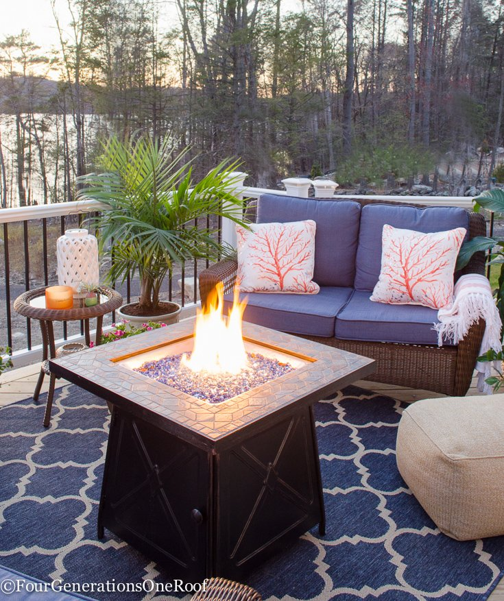firepit, coral pillow, blue rattan outdoor wicker set, green blue vase, white vase, indoor plant