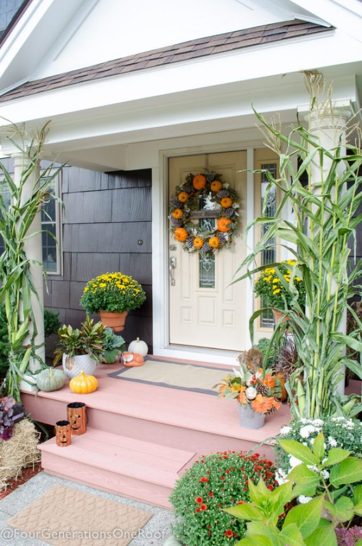 Orange Harvest Front Door decked out for Fall with pumpkins and mums