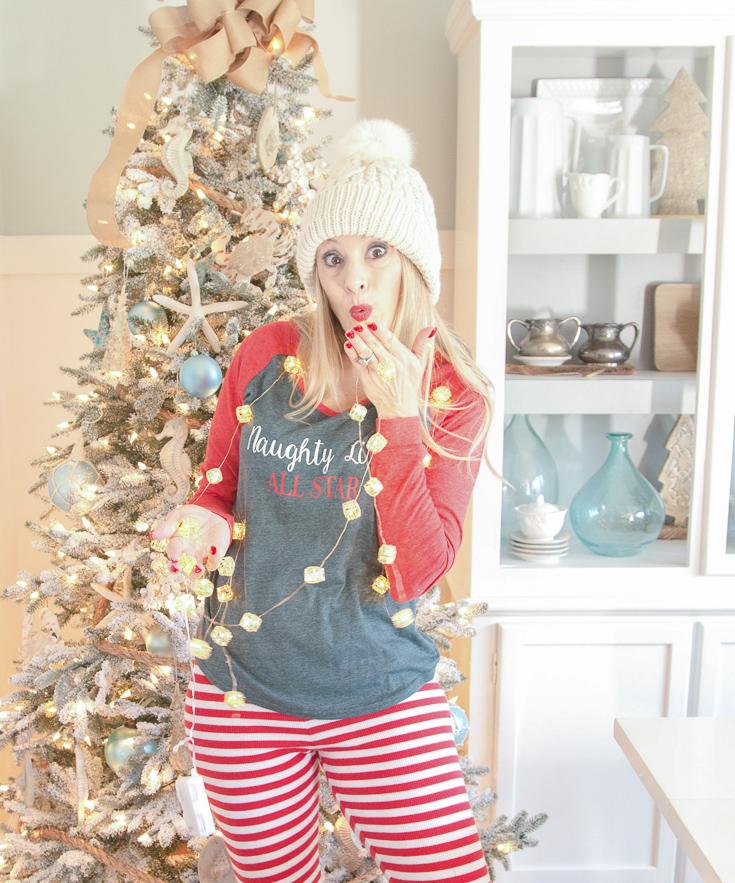Christmas pajamas | striped red and white pajama bottoms | Christmas tree | Christmas hat | Naughty or Nice Christmas shirt