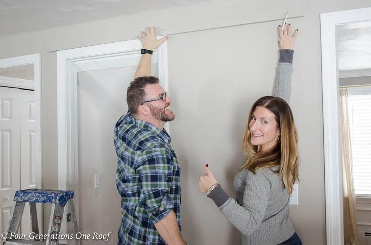 husband and wife installing sliding door hardware, Barn Door Installation without Removing Door Trim