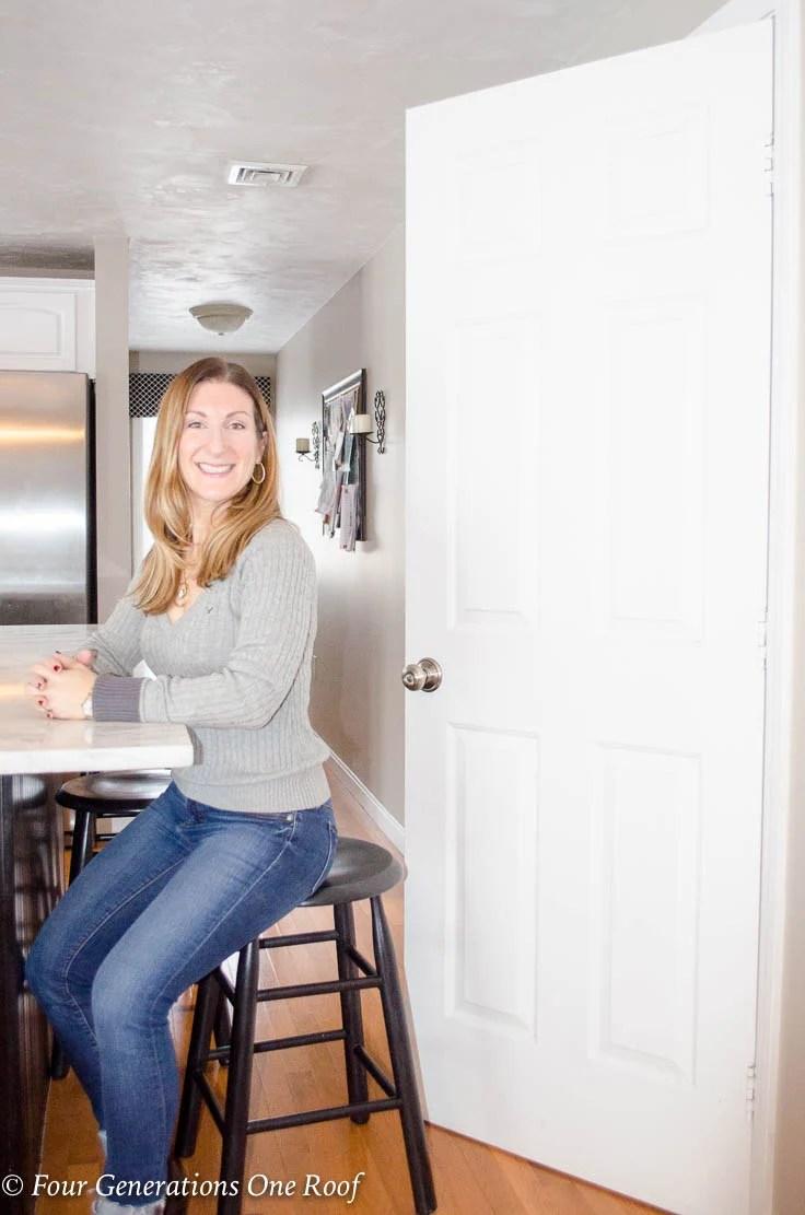 Woman sitting on stool , White basement kitchen door Barn Door Installation without Removing Door Trim