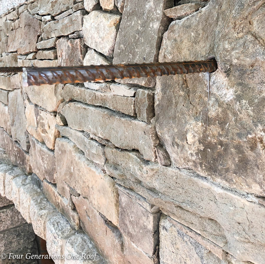 stone fireplace with rebar rod and liquid nail in hole