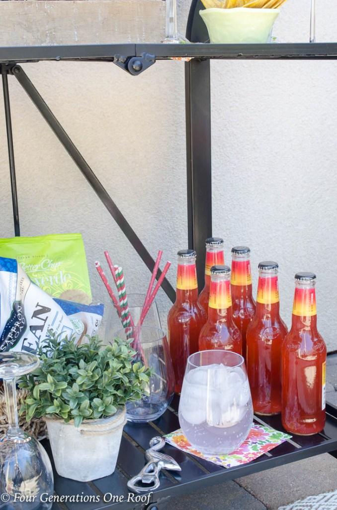 15 minute black metal bar cart setup   bottled fruit punch   straws   basket full of chips