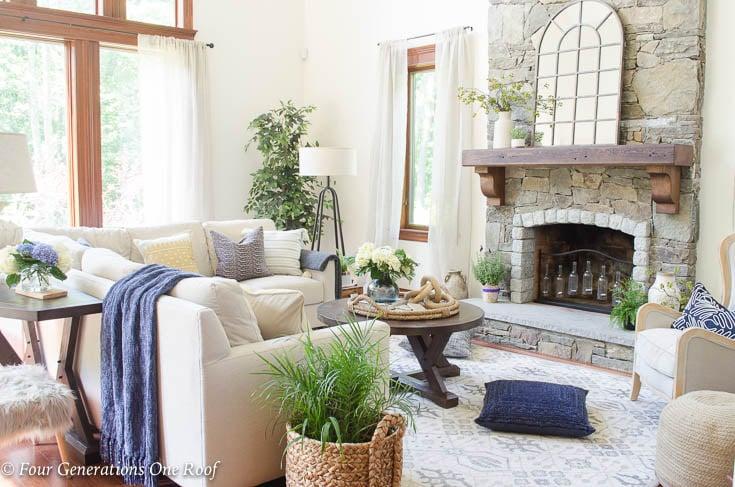 Rustic Modern Living Room with Wood beam Mantel + 50 foot ceilings