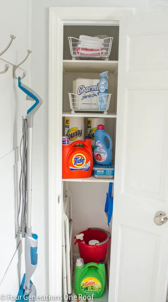 Bathroom Linen Closet Storage with wood shelves for laundry detergent, toilet paper, cleaning supplies and mops