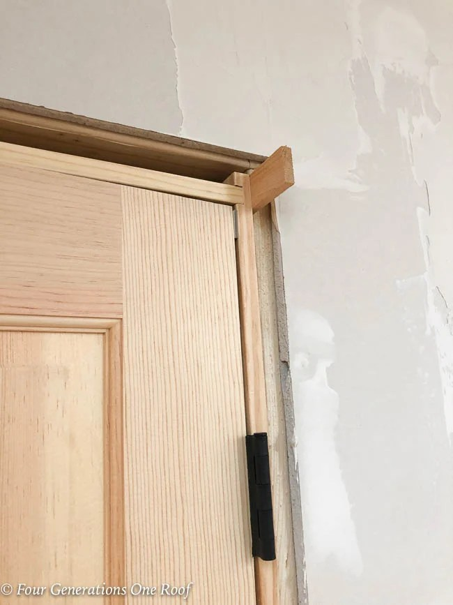 unfinished wood prehung french closet doors, installation with shims, nail gun