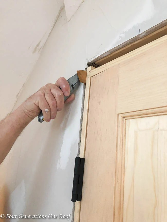 unfinished wood prehung french closet doors, installation with shims, stanley knife to remove shim