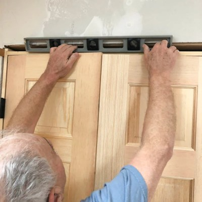 unfinished wood prehung french closet doors, installation with shims, nail gun, level