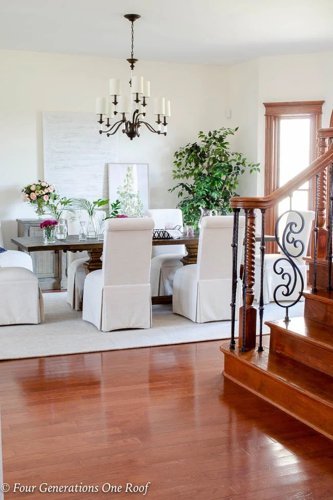 Arhaus dining table, slipcovered parson chairs, lighting updates Hinkley Modern Traditional Chandelier, greenery, Dash and Albert off white wool rug -1
