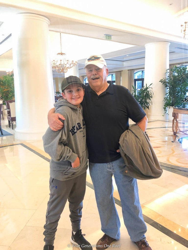 grandfather and grandson at Orlando Omni Resort in lobby