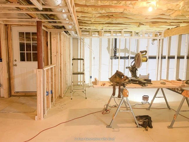 basement 2x4 frame walls against concrete and framed half wall