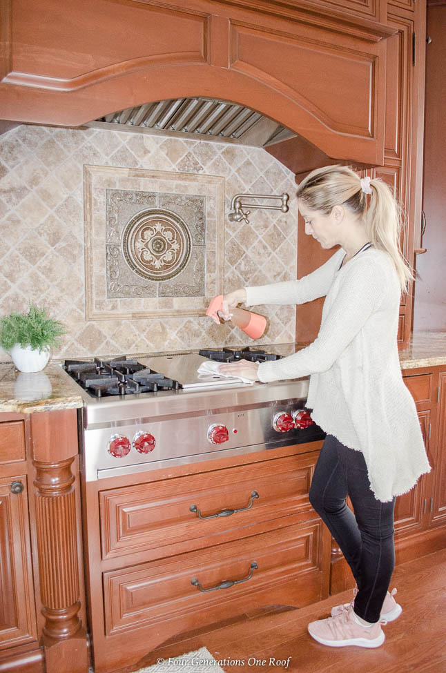 Jessica Bruno cleaning gas range top with Cleancult