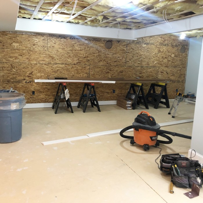 plywood basement wall before wood planks