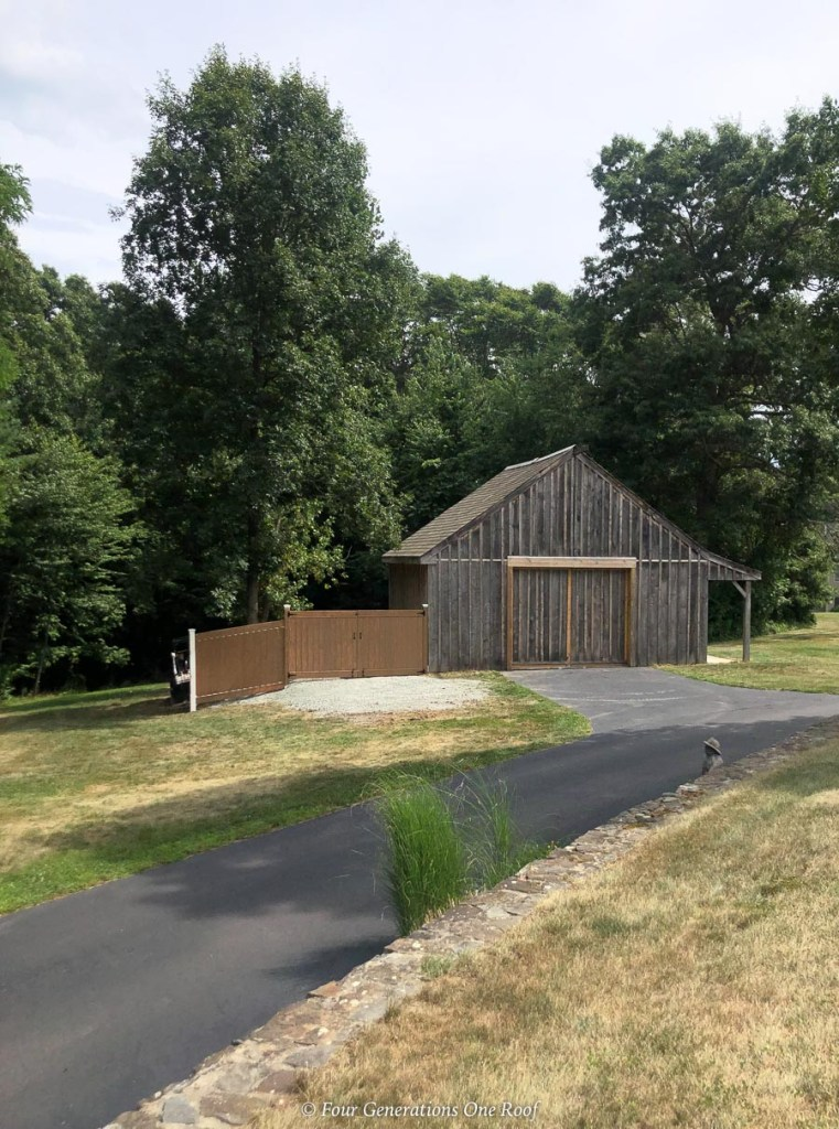 post and beam barn with pvc vinyl fence to hide a dumpster