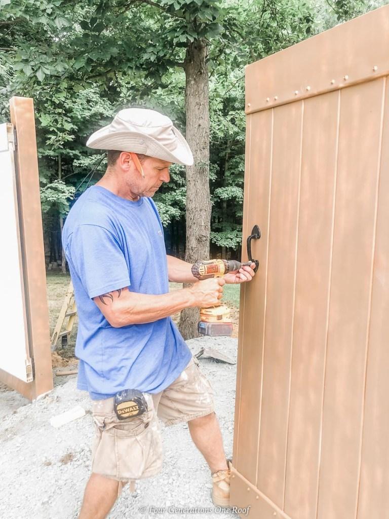 DIY PVC Fence Enclosure to Hide a Dumpster plus black handles