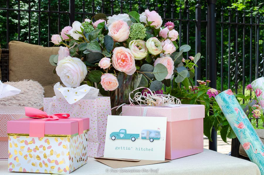 Backyard Patio Bridal Shower Gift Table with coordinating gift boxes and wrapping paper