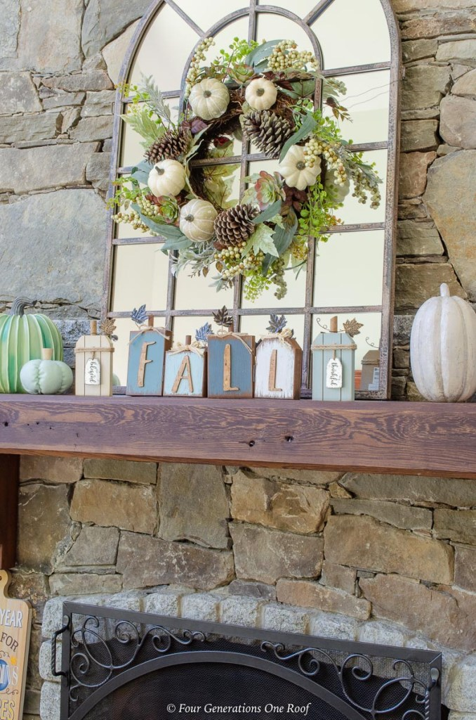 wood fireplace mantel, arched mirror, blue fall decor, blue fall wreath, green and blue pumpkins