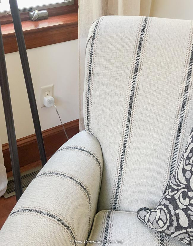 Enbrighten Wi-Fi Indoor Smart Plugs next to white and blue stripped recliner