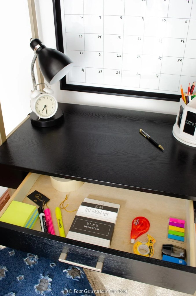 desk drawer filled with whiteout, post it notes, highlighters and erasers