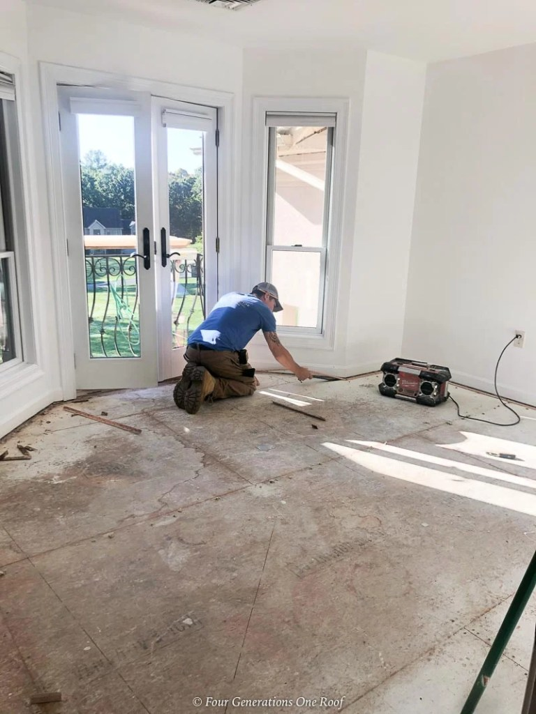 ripping up carpet, removing carpet staples