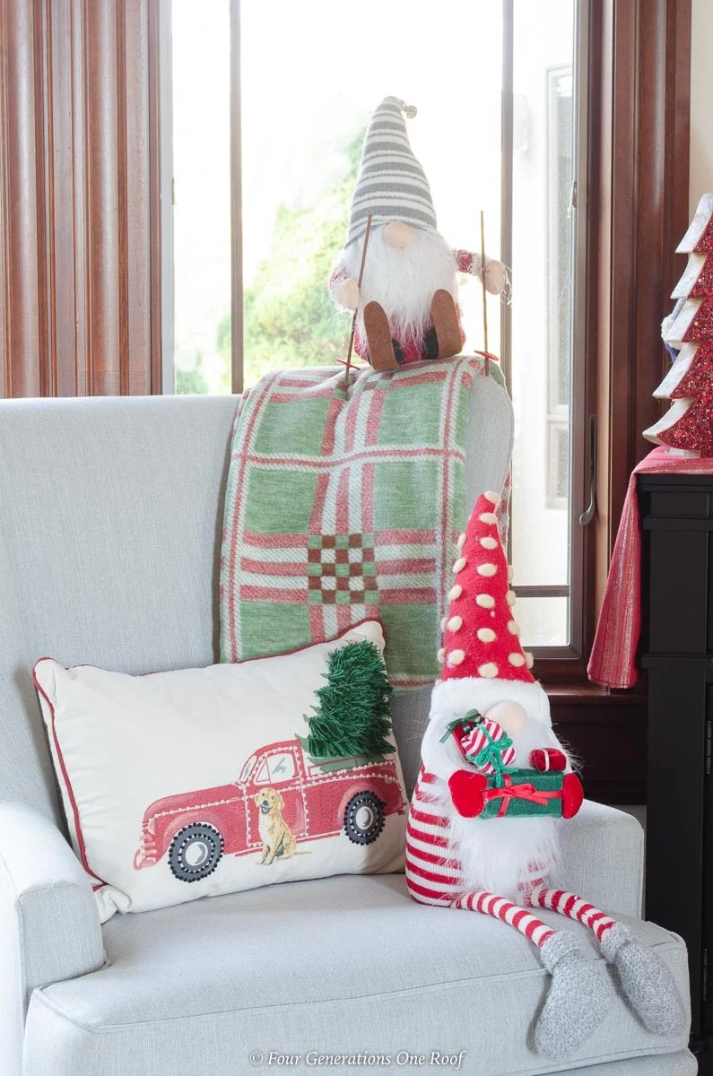 christmas gnomes, red vintage truck pillow, plaid green throw, accent chair