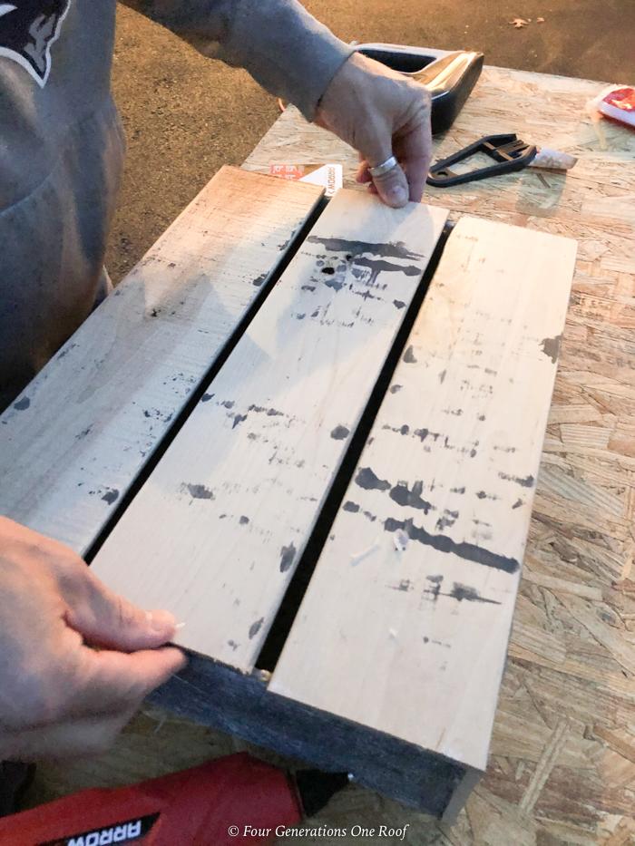 DIY Christmas crate glueing wood plank floor as the bottom