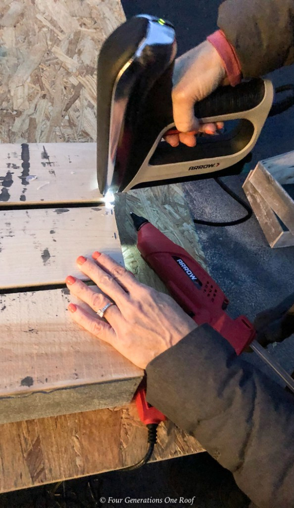 DIY Christmas crate Arrow staple gun fastening wood together