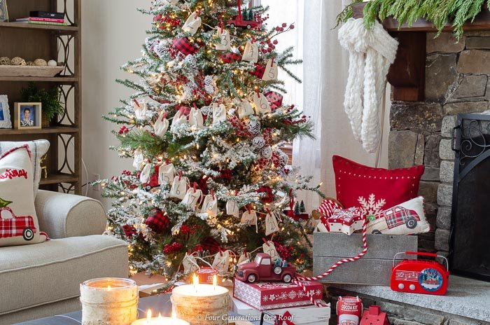 flocked tree, DIY gray wooden Christmas crate filled with red snowflake pillow, presents, red striped ribbon, red vintage boom box