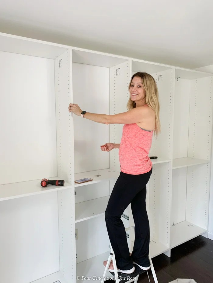 Jessica Bruno with white closet system with shelves and hanging racks