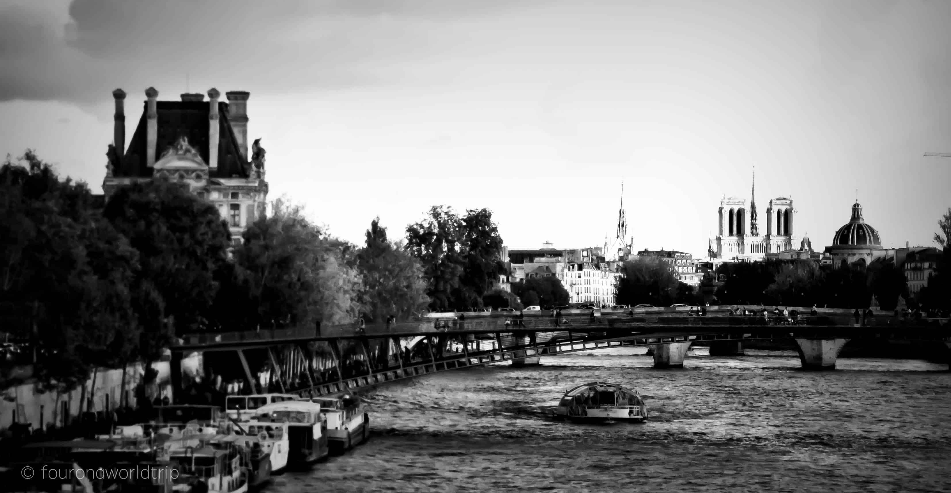 View over the Seine with Notre Dame in the back - explore Paris by bike and get the best views of the city