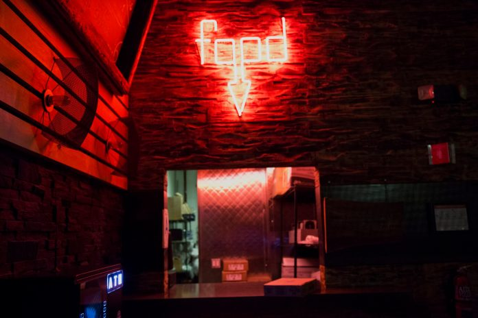Neon sign for food at Sound Nightclub