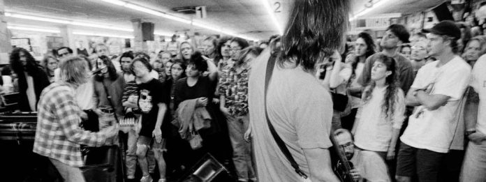 Nirvana performing to a crowd at the peak of Seattle grunge