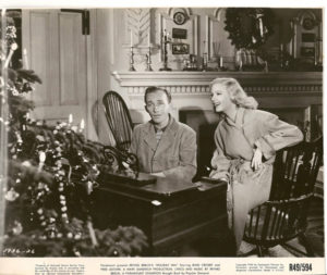 "Bing Crosby and Virginia Dale singing ""White Christmas"" in the film Holiday Inn (1942)"