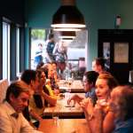 Photo by Kevin Curtis on Unsplash | background music at a restaurant