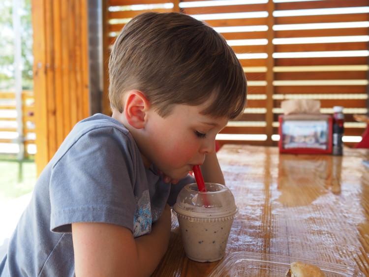 Foster drinking milkshake
