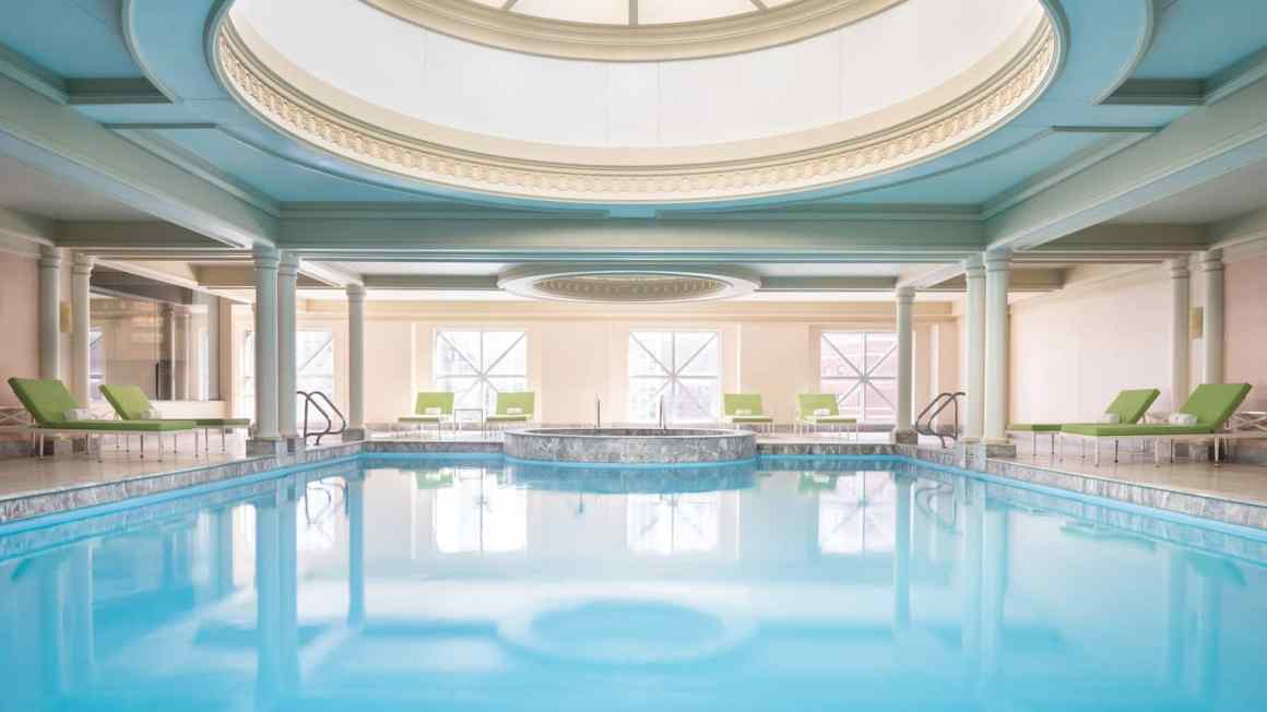 Indoor pool illuminated with natural light from large round ceiling window