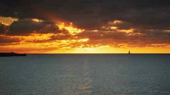 Bright orange sunset on the open ocean