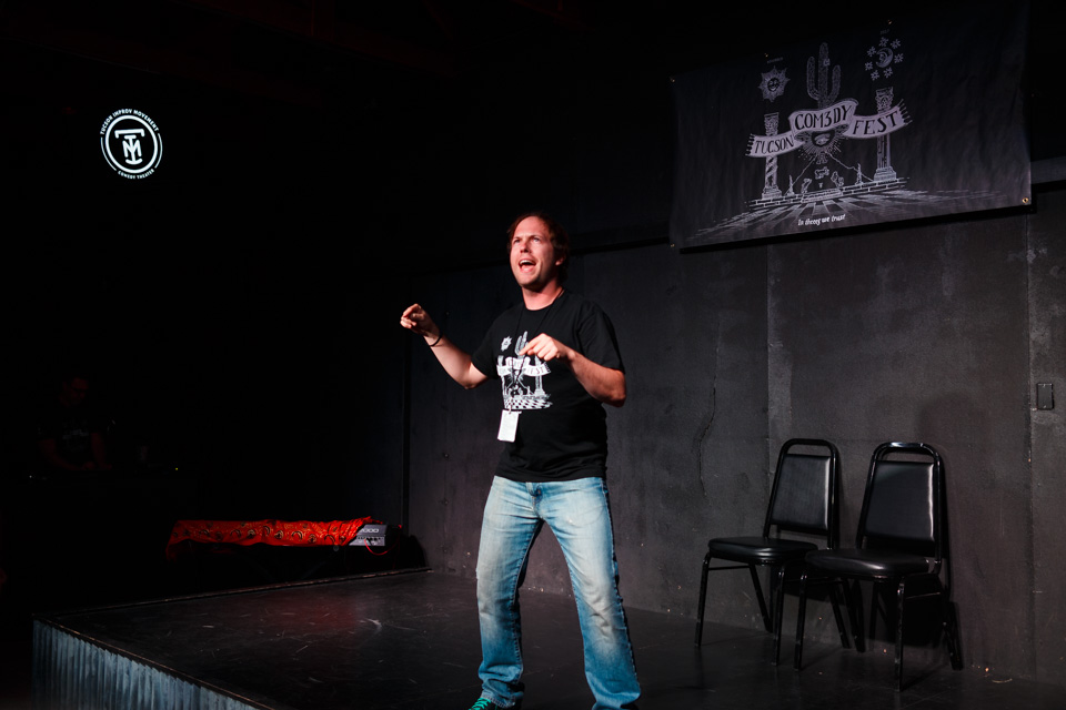 Justin performing on stage at the Tucson Improv Movement.
