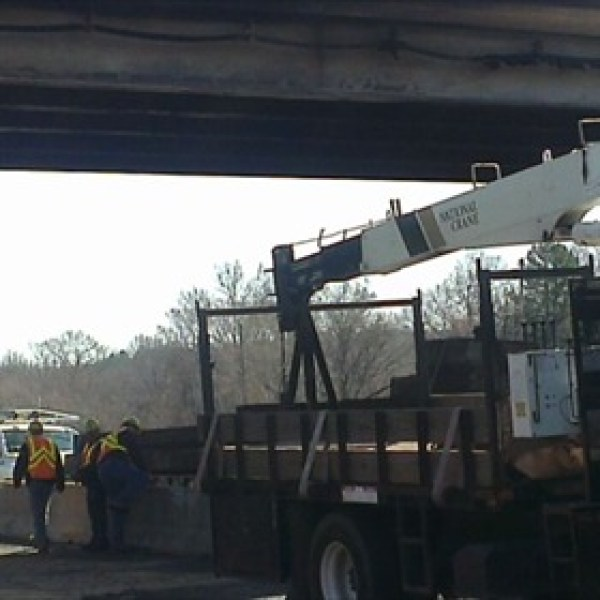 Crews Work at Young Road Overpass_-3716439875840490674