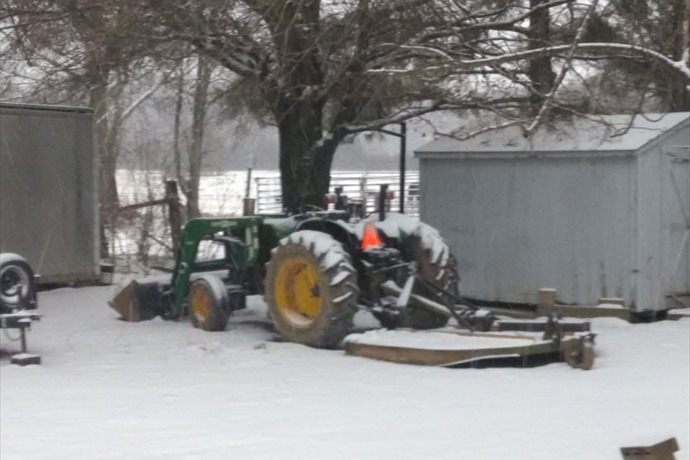 Snow-covered tractor in Atkins on Feb. 22._7650456519838354884