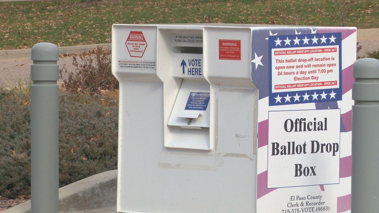 Voters returning ballots