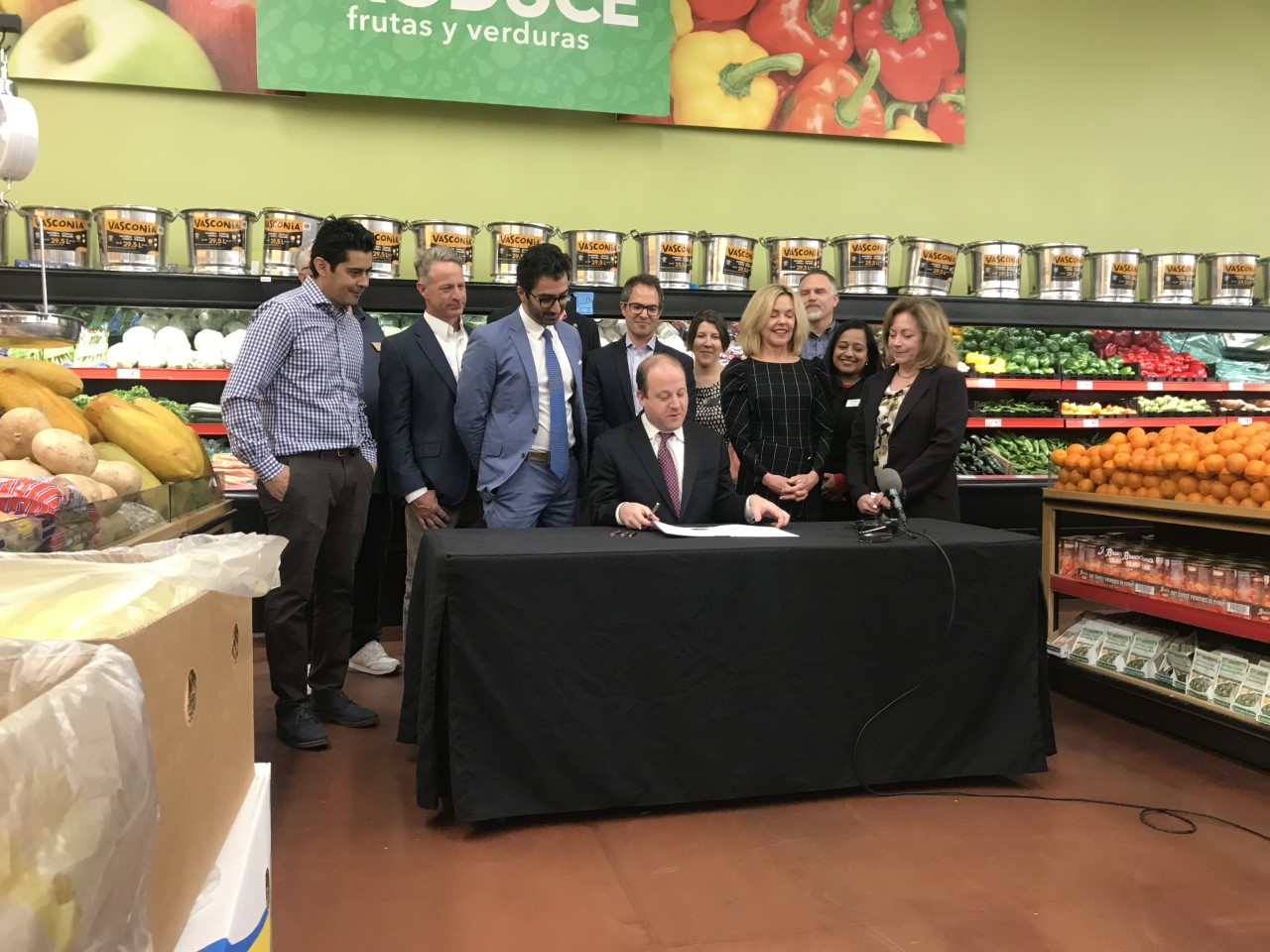 Gov. Jared Polis signs an executive order creating the Colorado Commission on Employee Ownership in Colorado Springs Wednesday morning. Brandon Thom