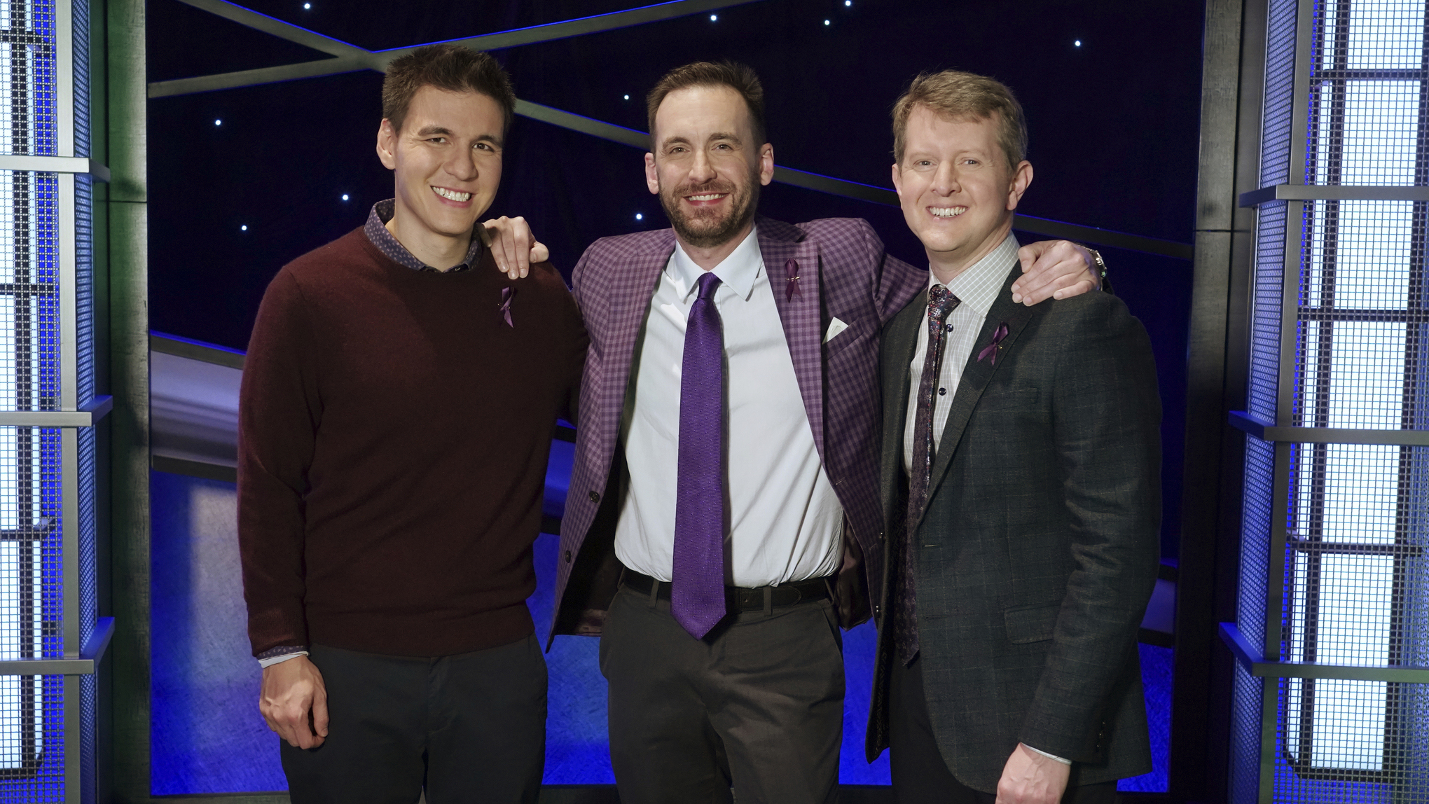 """In this image released by ABC, contestants, from left, James Holzhauer, Brad Rutter and Ken Jennings appear on the set of """"Jeopardy!"""" in Los Angeles (Eric McCandless/ABC via AP)"""