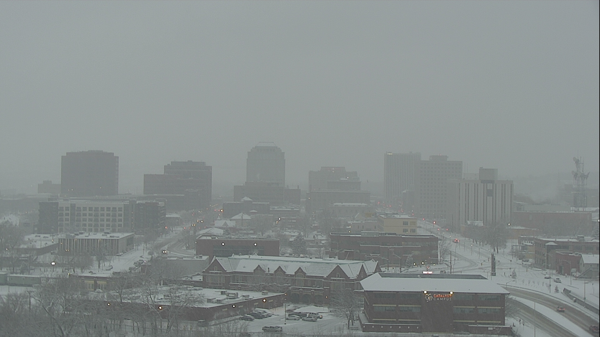Snow falls over downtown Colorado Springs around 7 a.m. Tuesday.