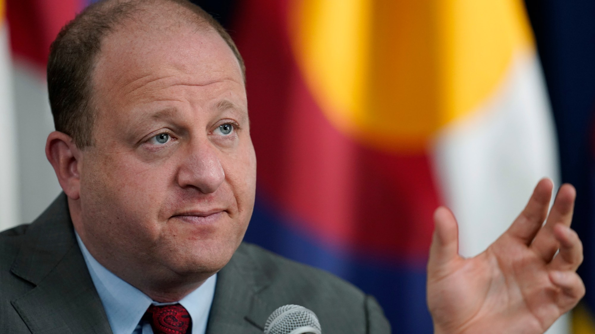 FILE - In this March 9, 2021, file photo, Colorado Governor Jared Polis makes a point during a news conference in Denver. (AP Photo/David Zalubowski, File)