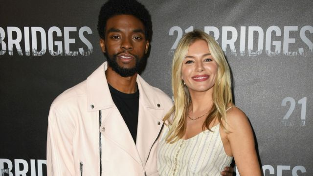 """Chadwick Boseman and Sienna Miller attend the photocall for STX Entertainment's """"21 Bridges"""" at Four Seasons Hotel Los Angeles at Beverly Hills on November 09, 2019 in Los Angeles, California. (Photo by Jon Kopaloff/Getty Images)"""