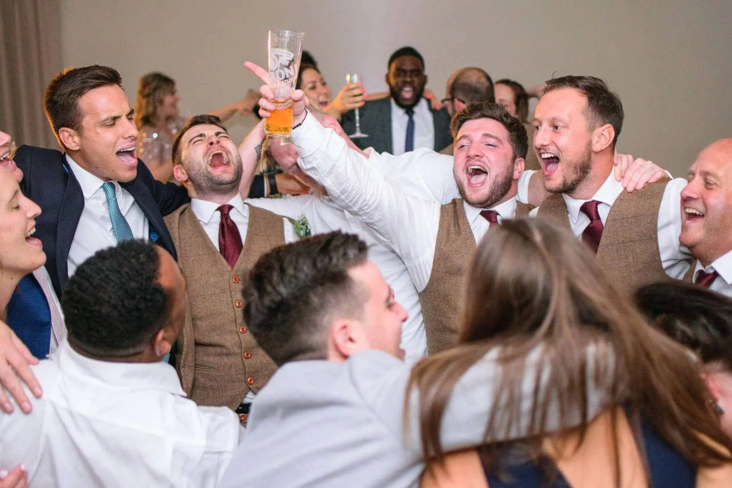 guests singing together at a wedding
